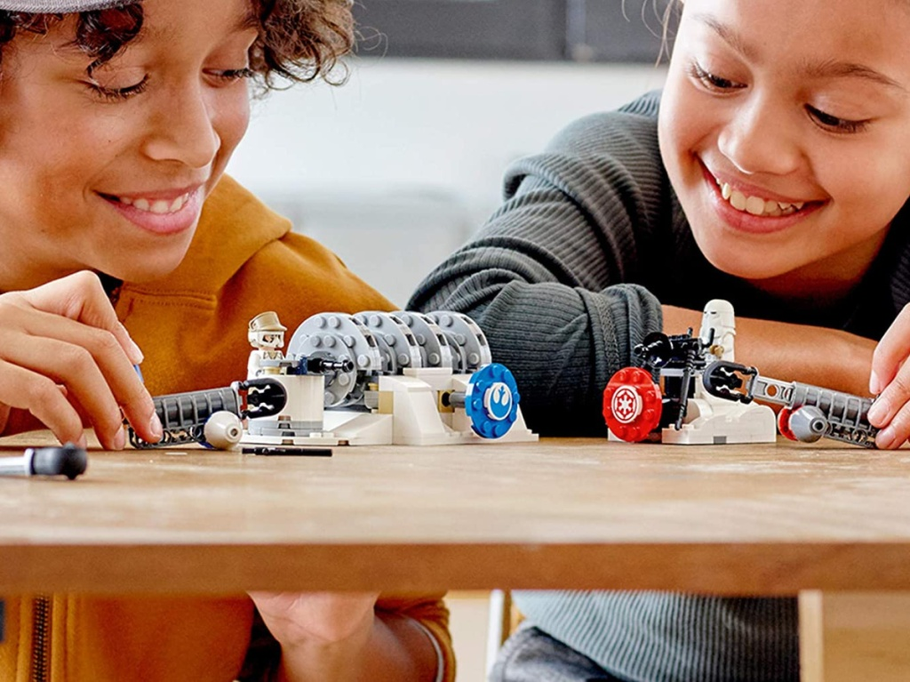 two kids playing with Star Wars LEGO toy kit