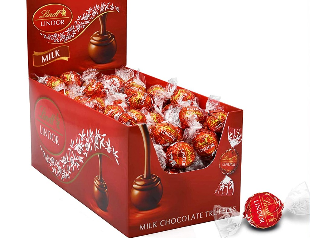 red box full of round Lindt individually wrapped truffles