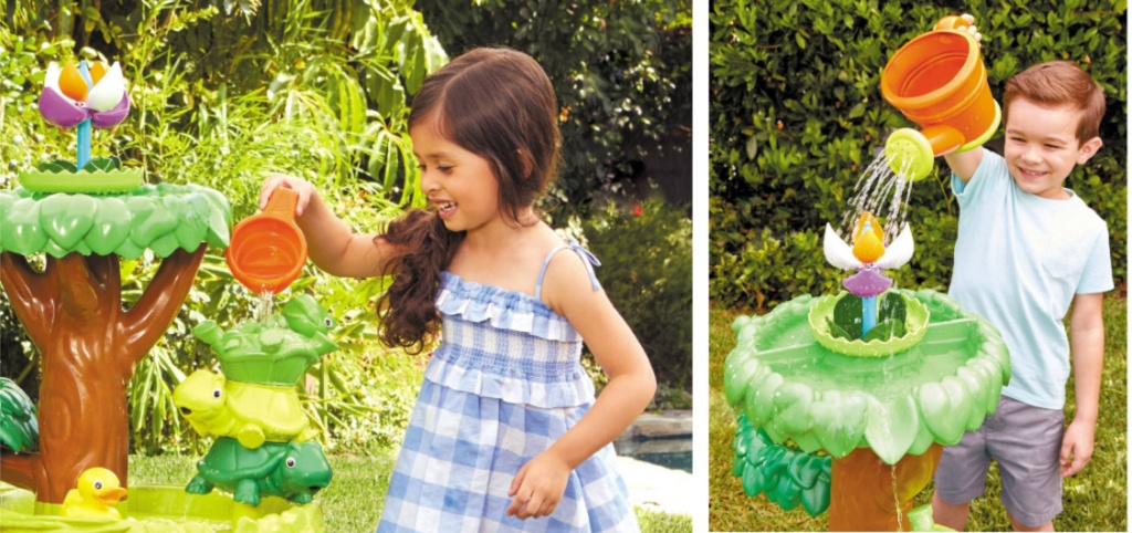 girl and boy playing with flower water table