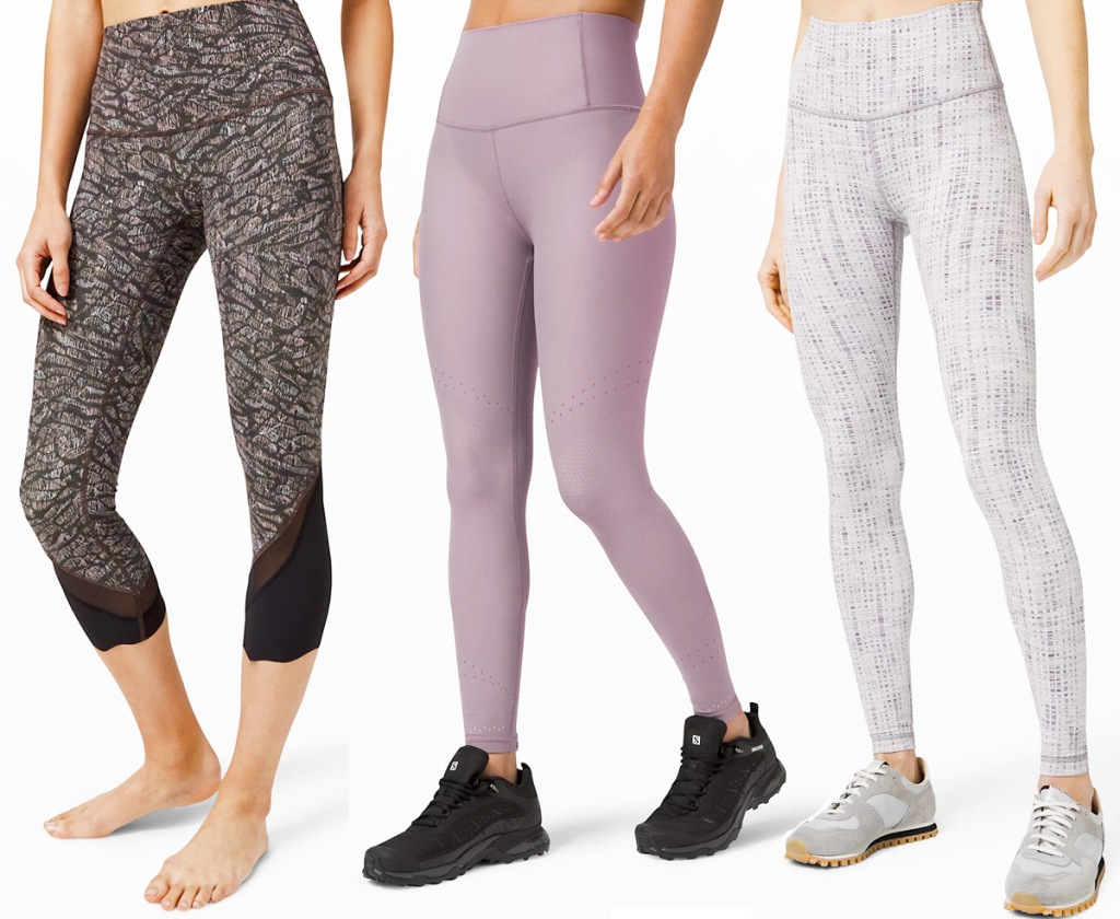 three women modeling leggings in black & white, lilac, and white & grey colors