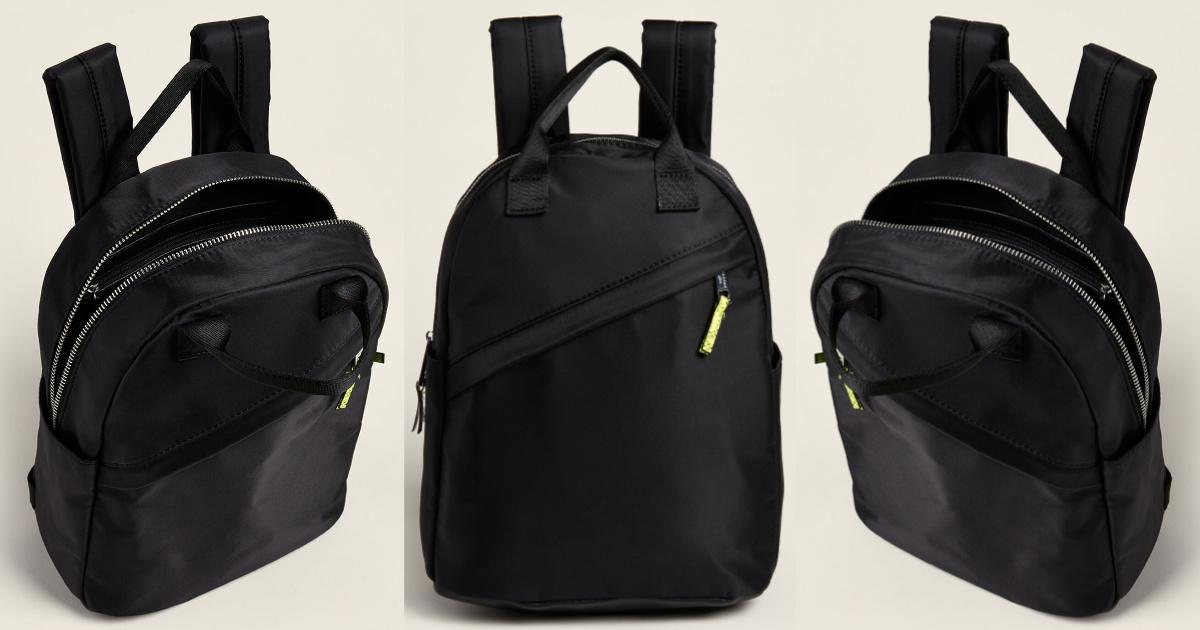 closed black nylon backpack and two open black nylon backpacks
