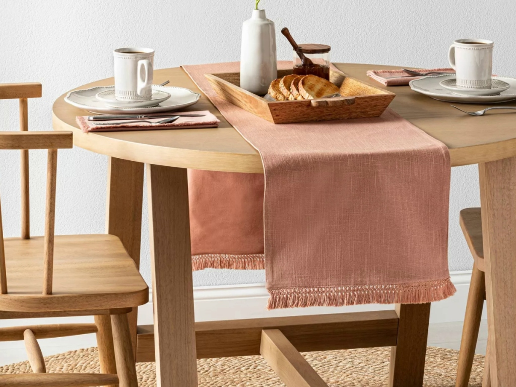 Wooden dining set with pink table runner