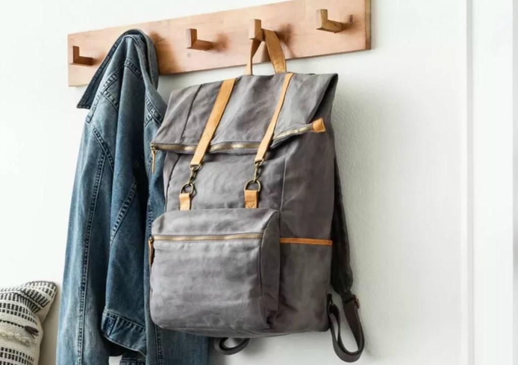 Large gray bag hanging on a coat rack