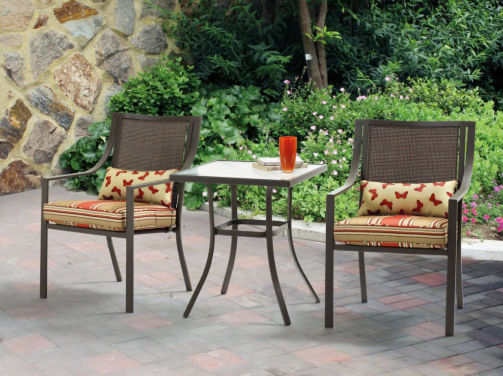 orange patio bistro set outdoors