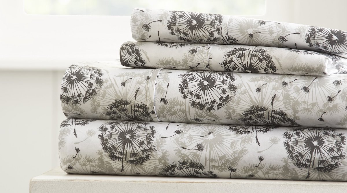 stack of sheets with dandelion images on them