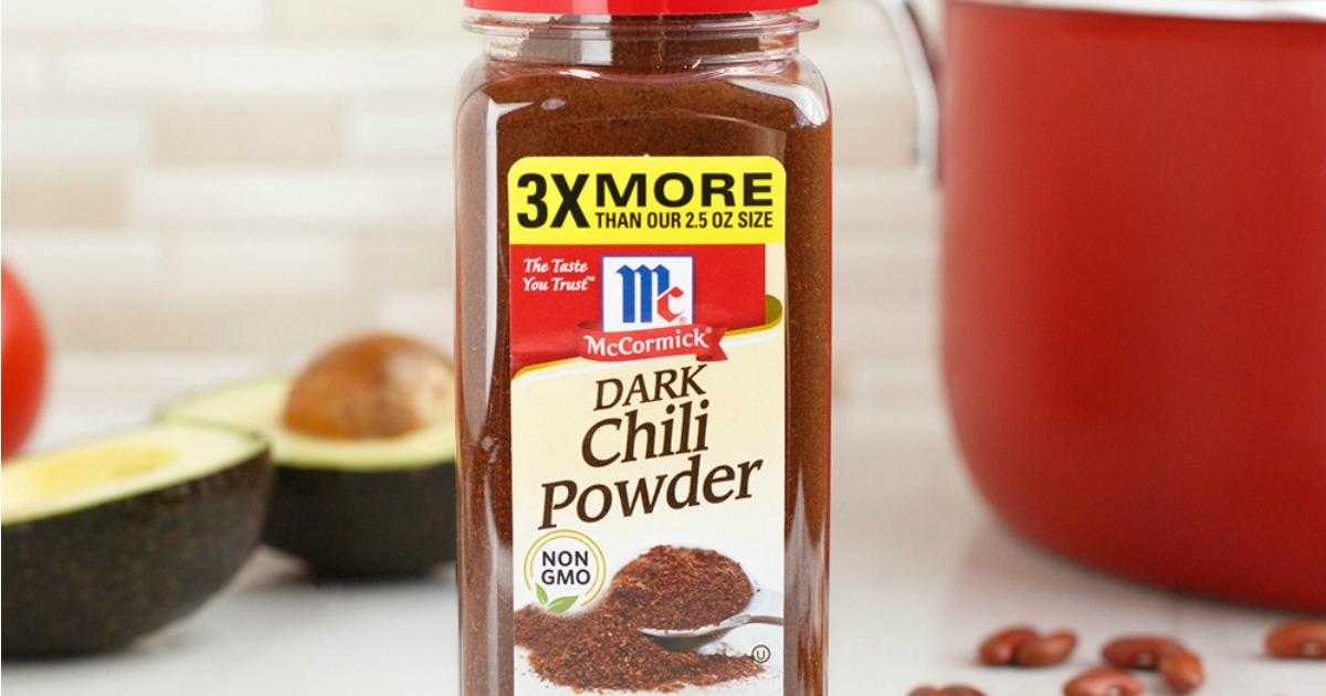 McCormick Dark Chili Powder in front of pan and avocado