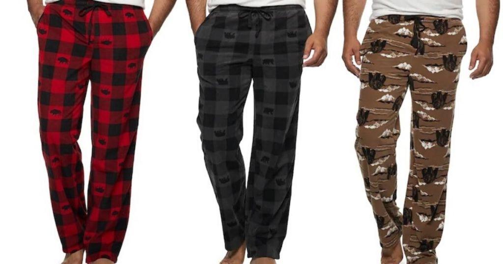 three men wearing fleece pajama pants