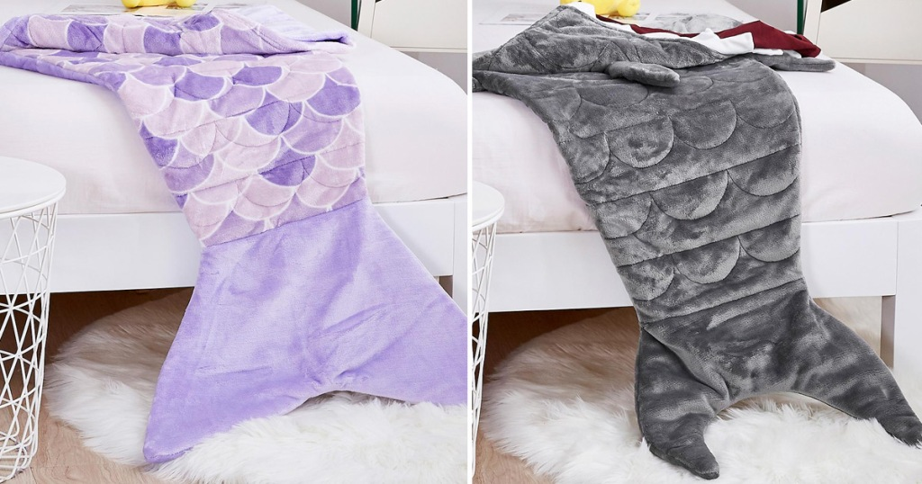 purple mermaid tail shaped weighted blanket and grey shark tail weighted blanket laying on beds