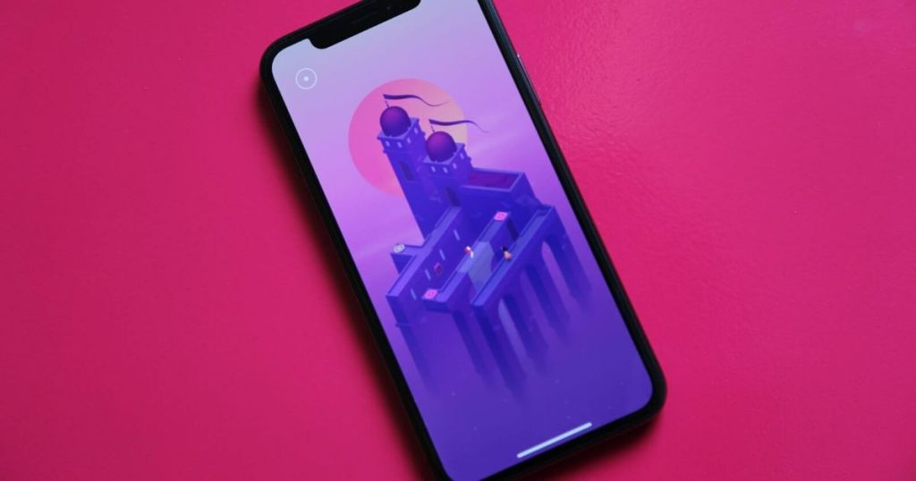 iphone with monument valley 2 game on the screen