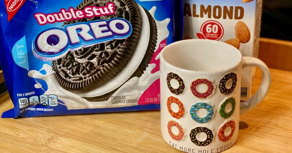 Package of oreos, milk and a mug on the counter