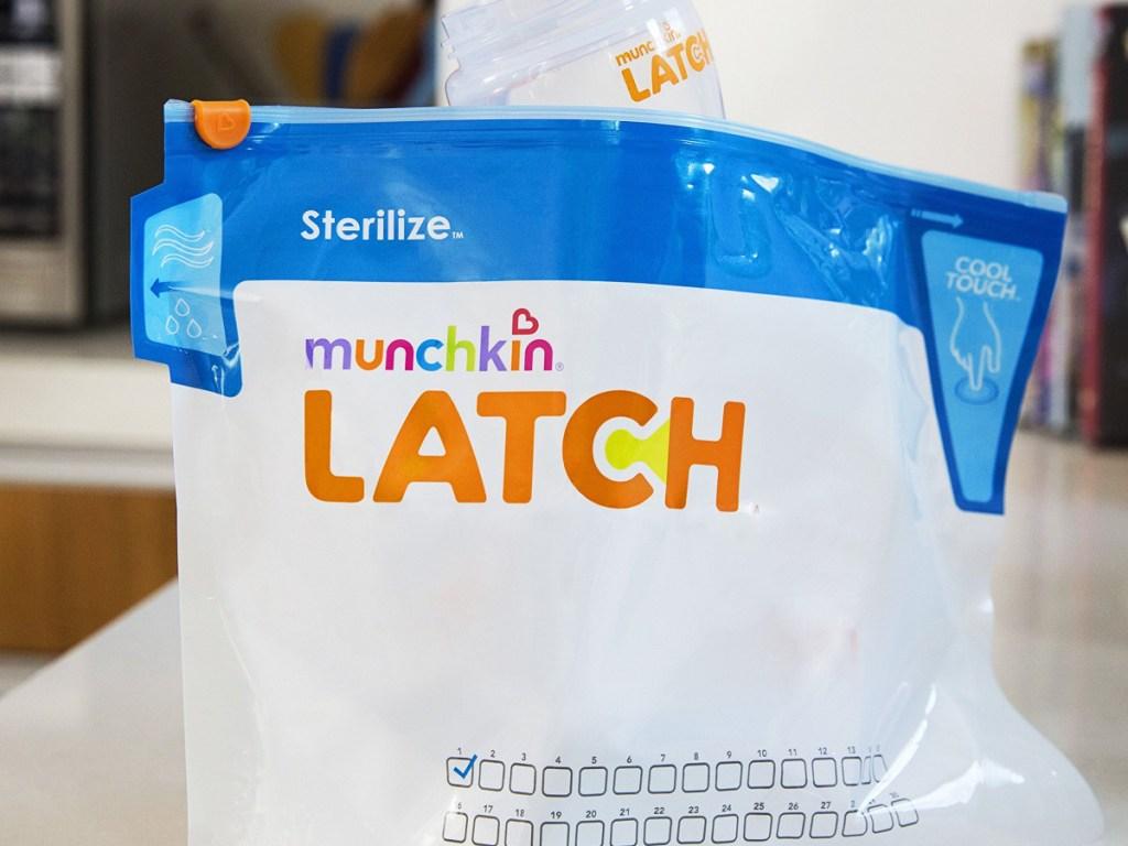 Munchkin Sterilize Latch Bags sitting on kitchen counter