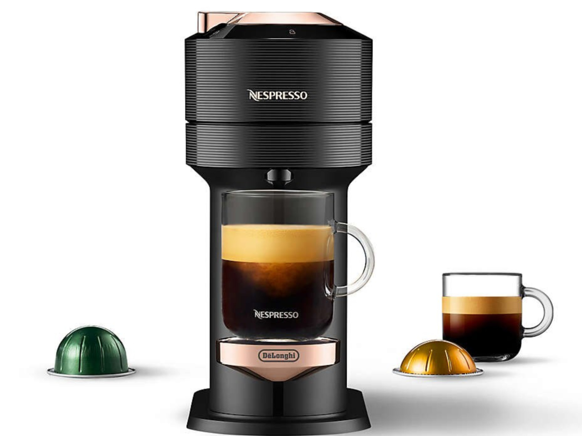 DeLonghi Nespresso Maker with coffee cup and pods