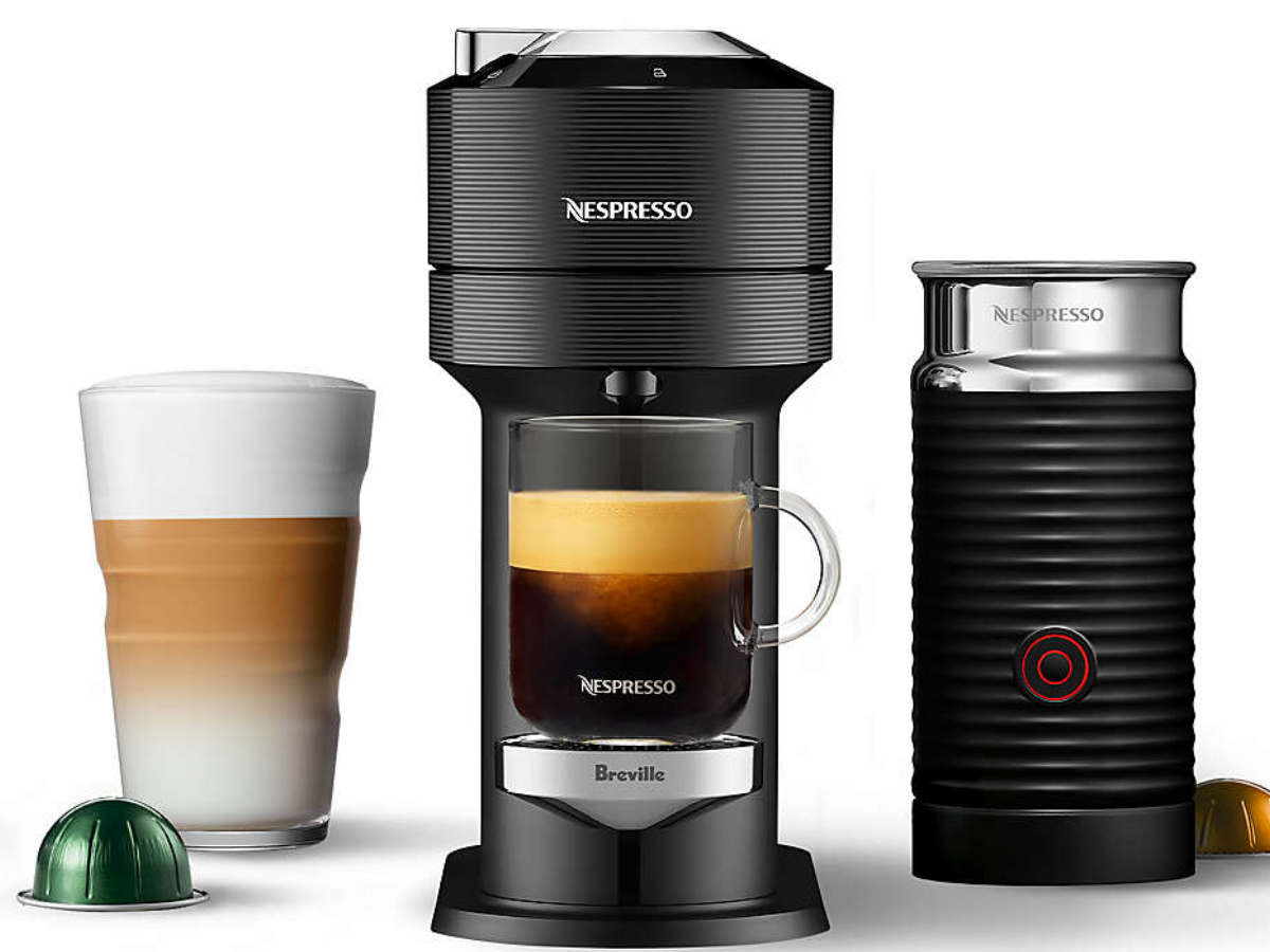 Breville Nespresso Maker and frother with glass of coffee and pod