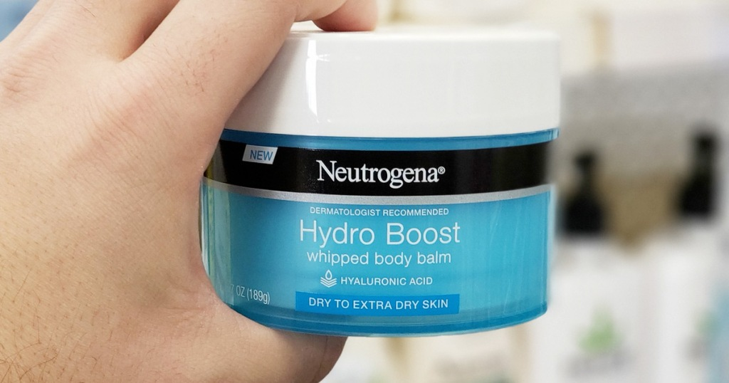 person holding up blue container of neutrogena hydro boost balm