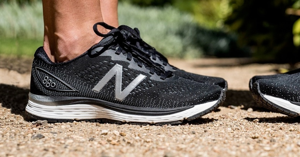 person wearing black pair on new balance running shoes