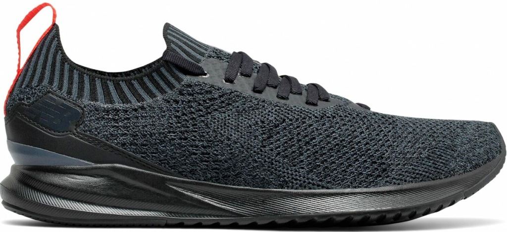 mens black knit new balance running shoe with black sole and laces