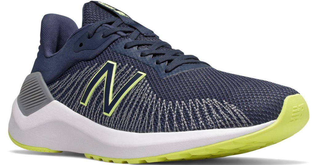 navy blue mesh running shoe with lime green details and bottom sole