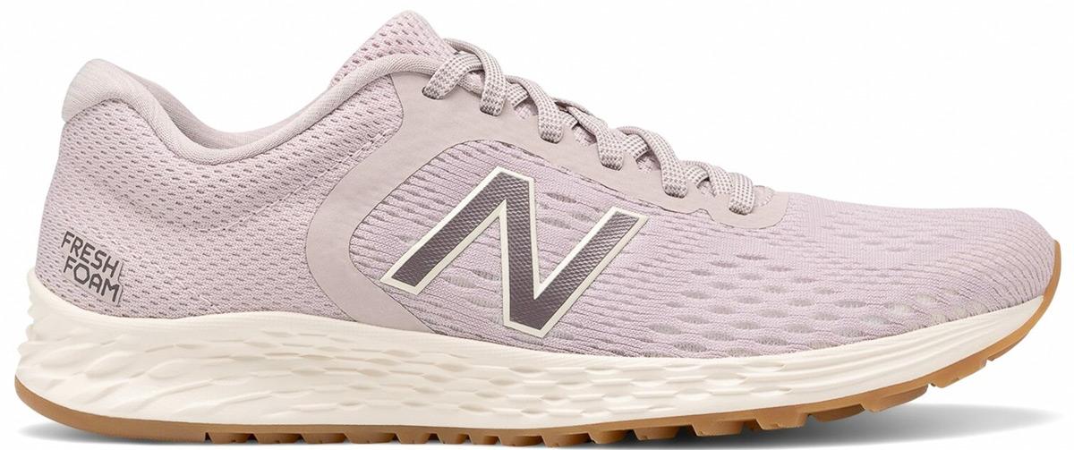 light pink mesh new balance running shoe with white foam sole