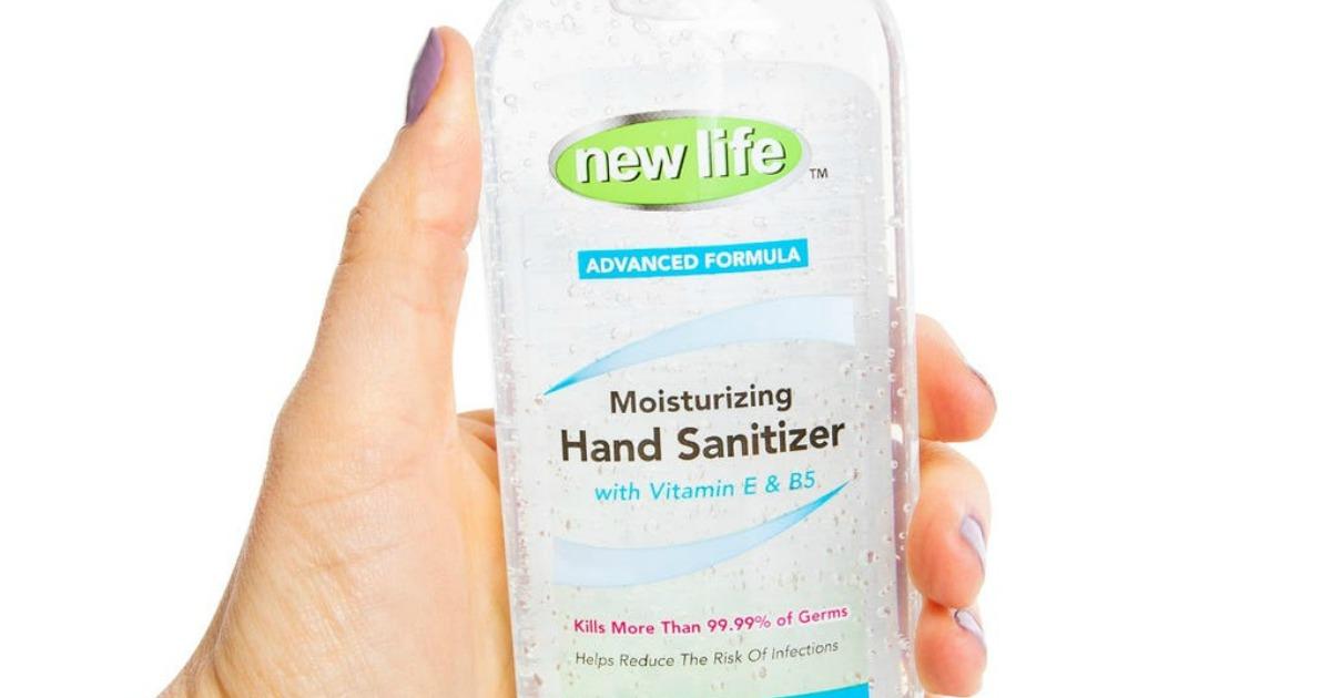 hand holding bottle of hand sanitizer