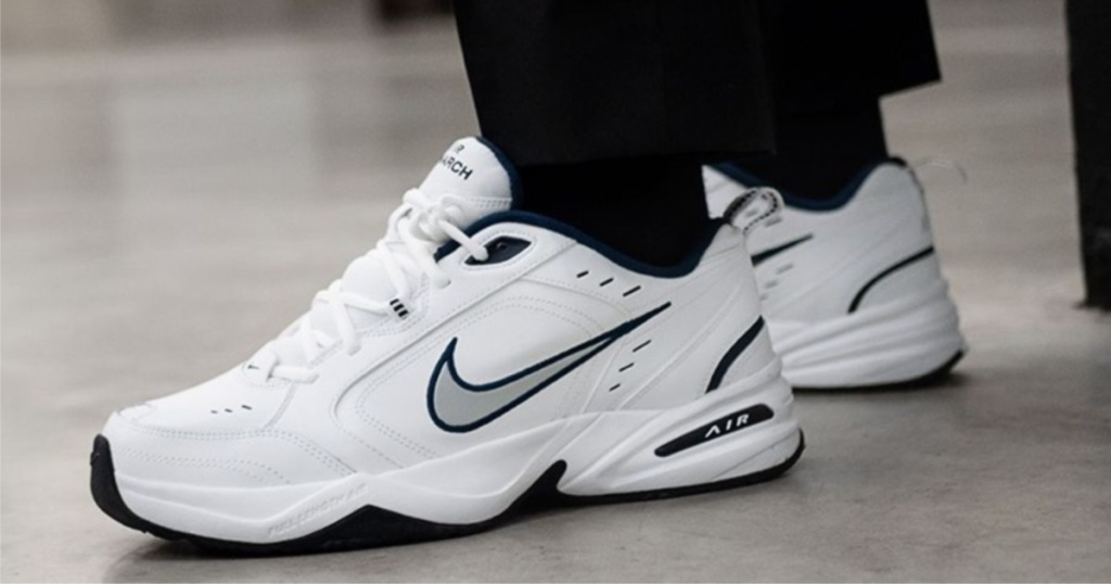 white and silver Nike shoes on feet