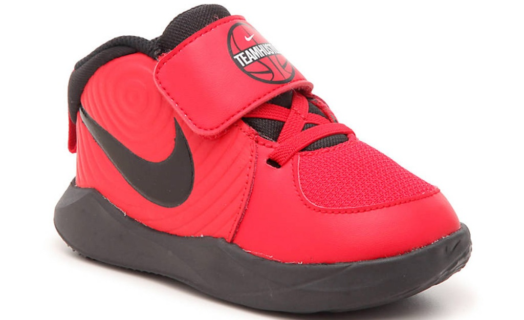 toddler boys red nike sneaker that says teamhustle on tongue