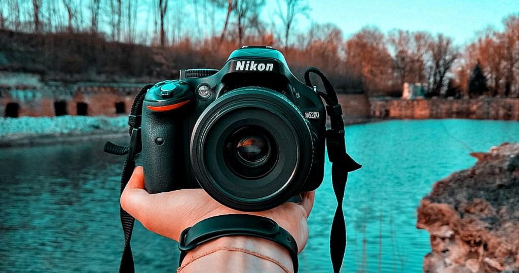 Nikon camera in man's hand