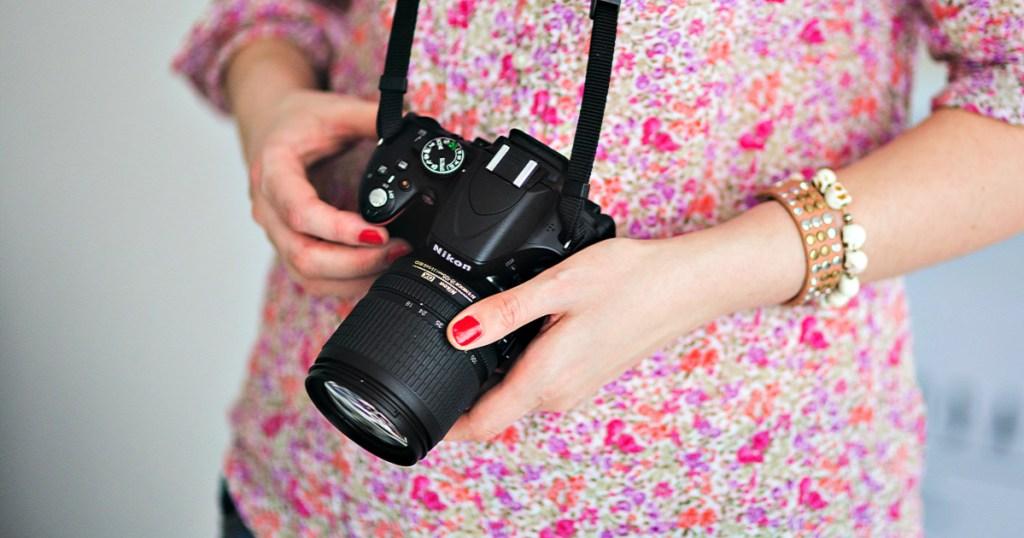 Nikon camera in woman's hands