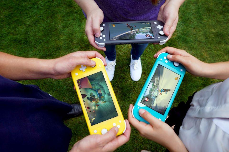 kids holding Nintendo Switch LIte consoles