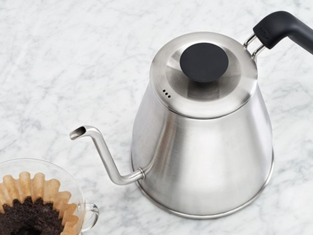 brushed kettle with coffee filter on marble surface