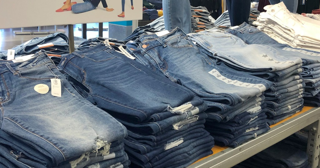 store display table of different washes of jeans