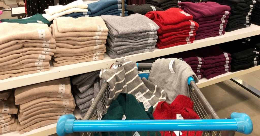 a shopping cart full of sweaters at an old navy store