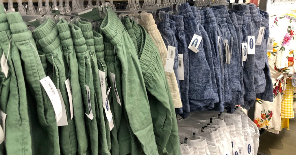 store display racks of womens shorts in olive green and blue colors