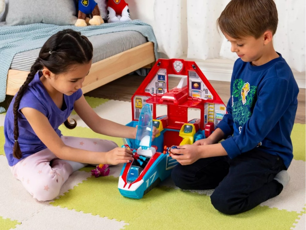 Kids playing with PAW Patrol Super Mighty Pups Transforming Jet Command Center