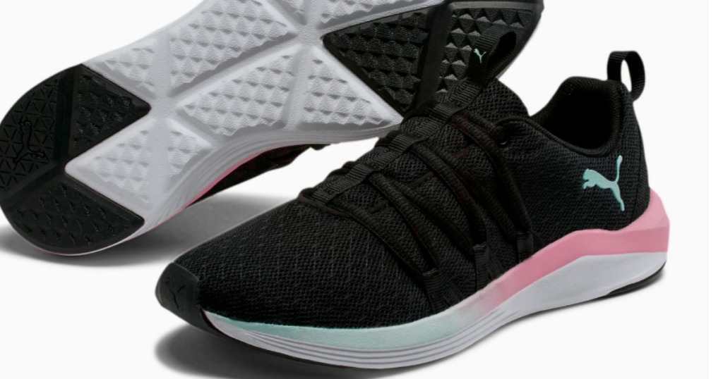 women's black and pink sneaker with a mint-colored puma logo