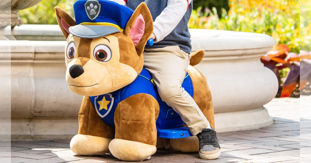 child riding on a chase from paw patrol shaped ride-on toy