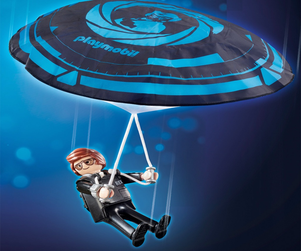 playmobil person in black tuxedo with blue and black parachute