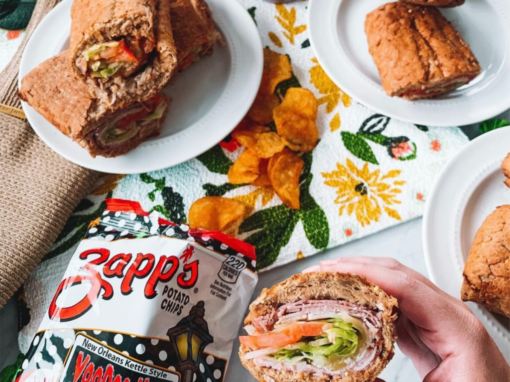 various sandwiches and open chip bag