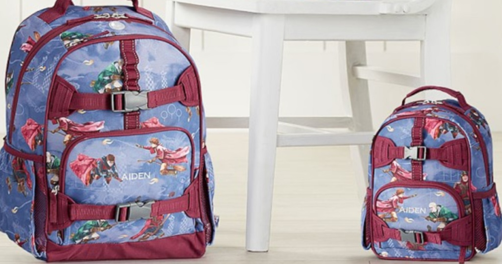 two kids harry potter backpacks sitting on the floor next to a white chair