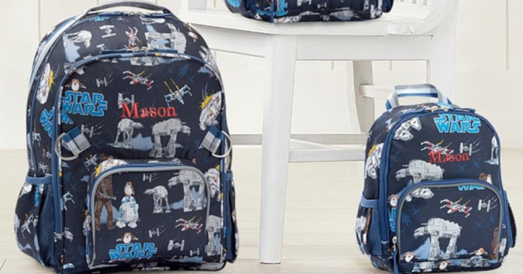 two pottery barn kids star wars backpacks sitting next to each other on the floor
