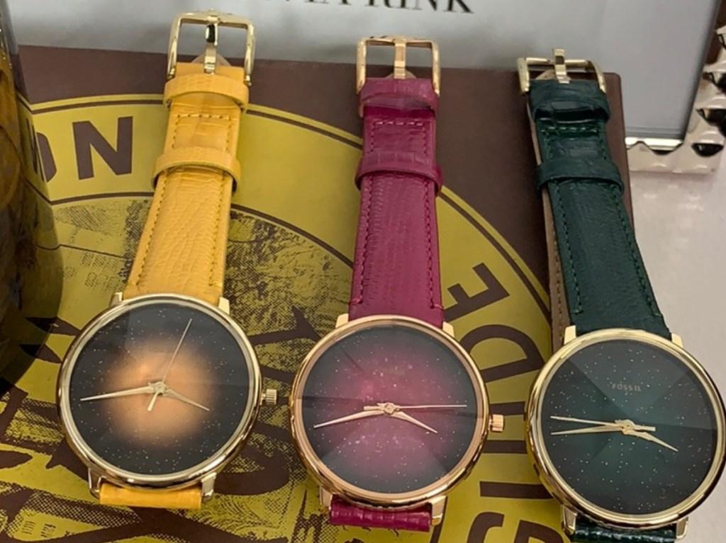 yellow, maroon, and dark green watches