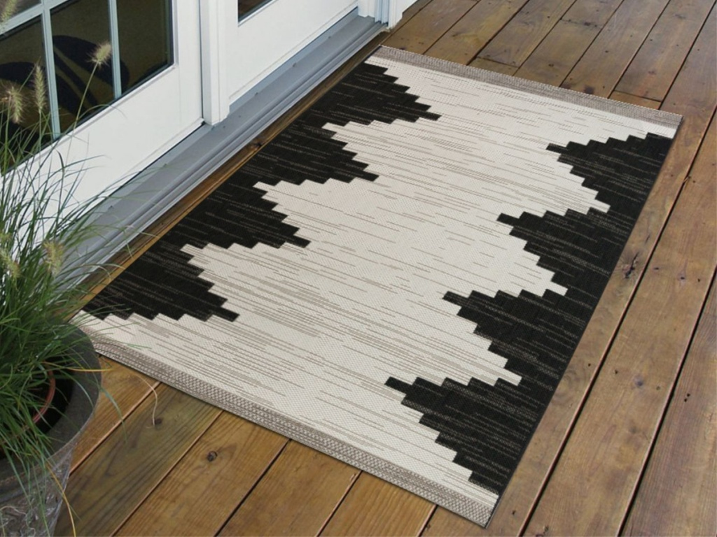 white and black outdoor area rug on deck
