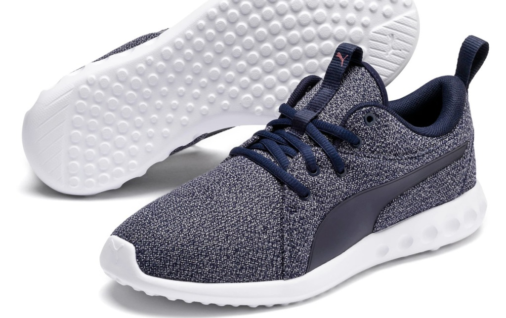 navy blue knit running shoe with white sole