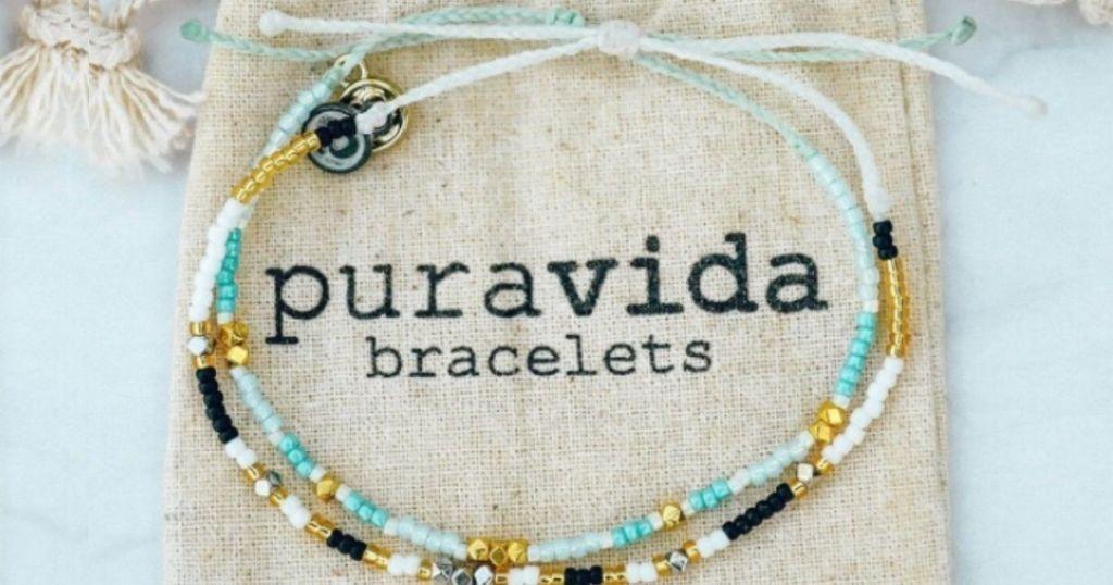 pura vida beaded bracelet set on pouch