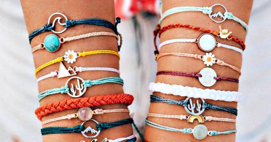 Pura Vida bracelets on hands