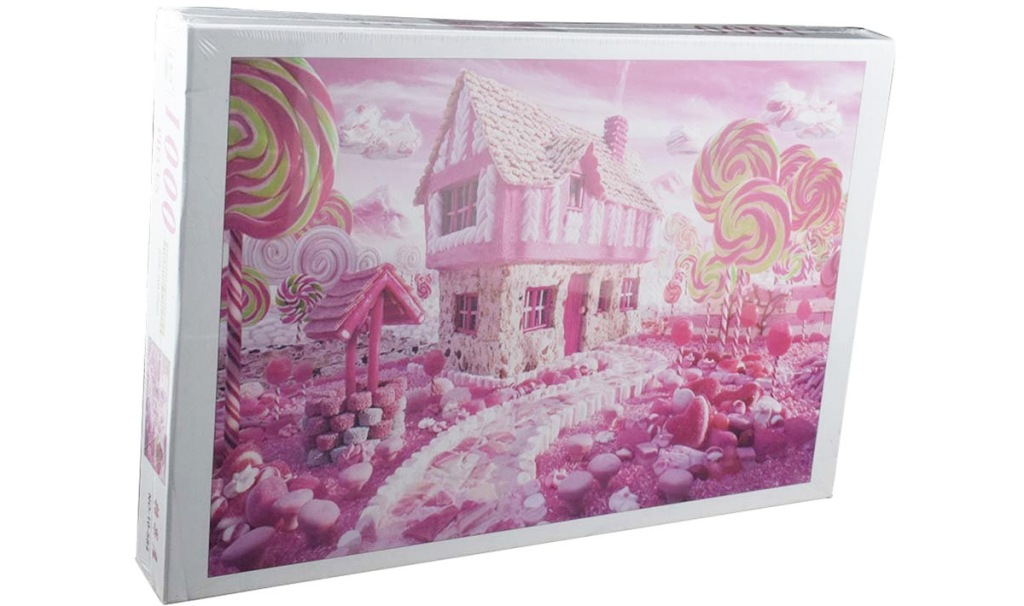 puzzle box with a photo of a pink house and yard made out of candy
