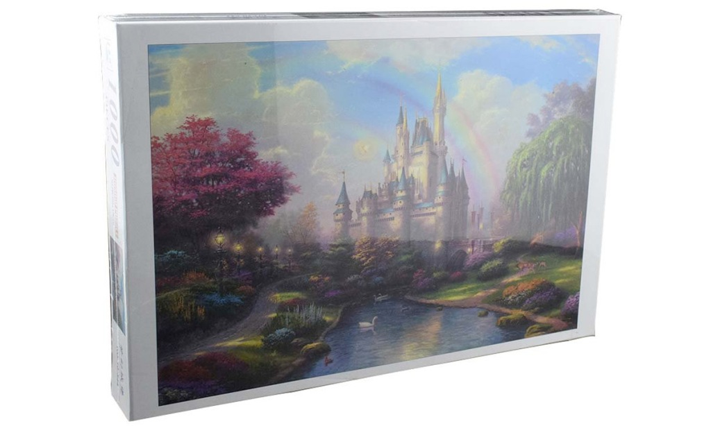 puzzle box with a photo of a fairy tale castle with rainbow over it