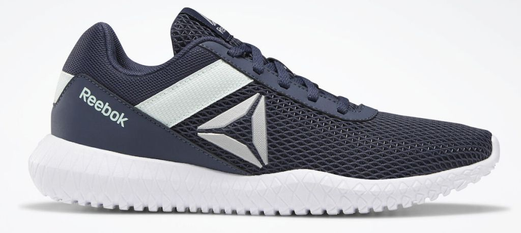 white and black Reebok shoes