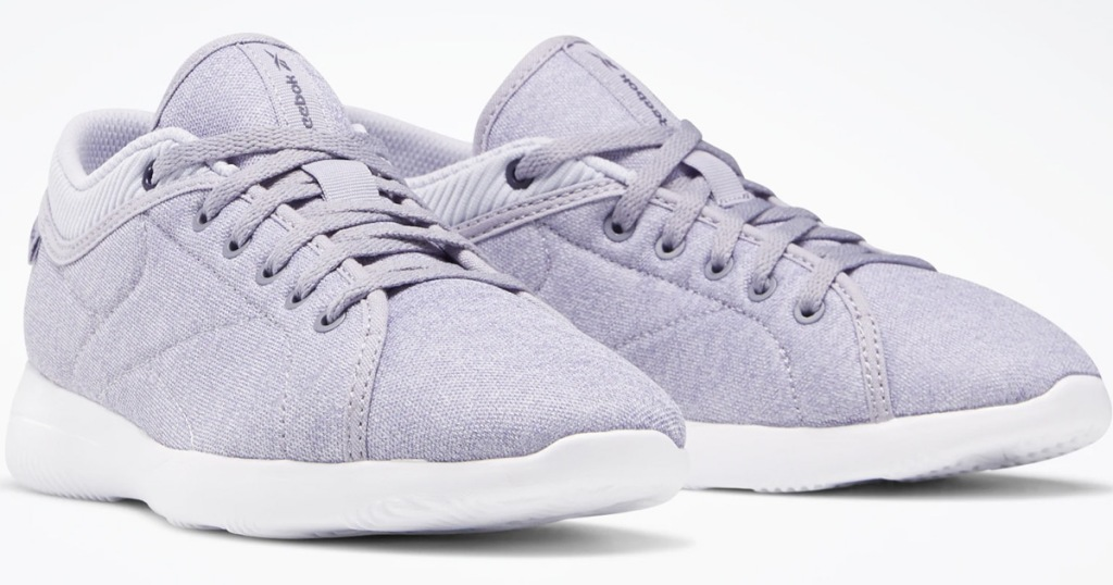 pair of light purple cloth reebok brand walking shoes with white soles