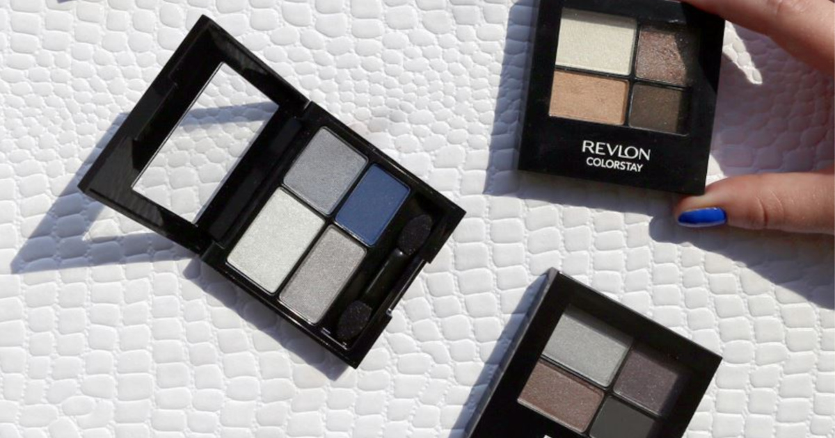 three various colored eyeshadow quads of white embossed background
