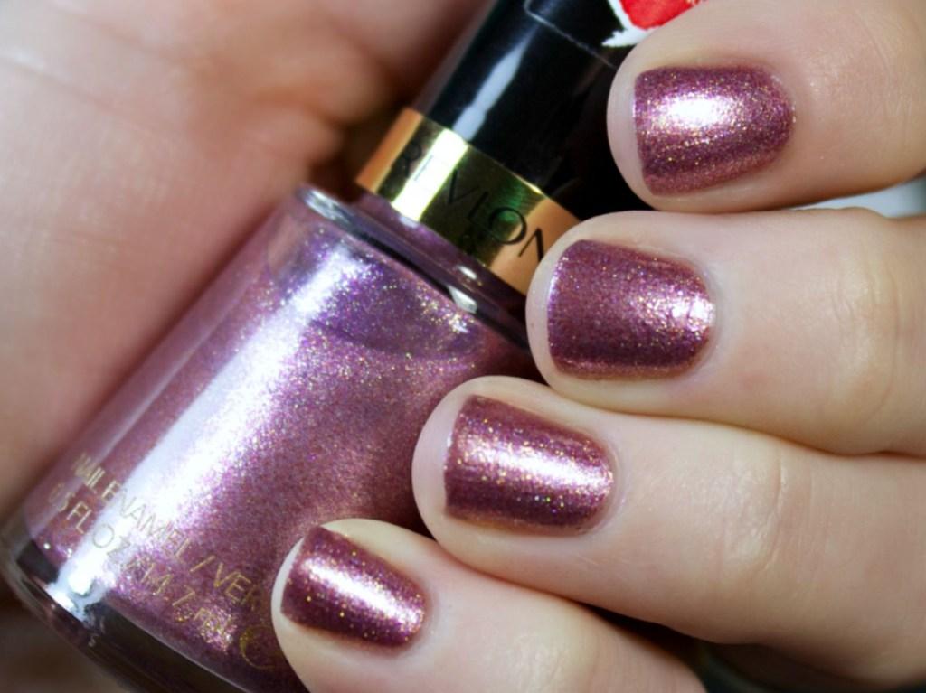 nail polish bottle and nails painted glitter pink/purple